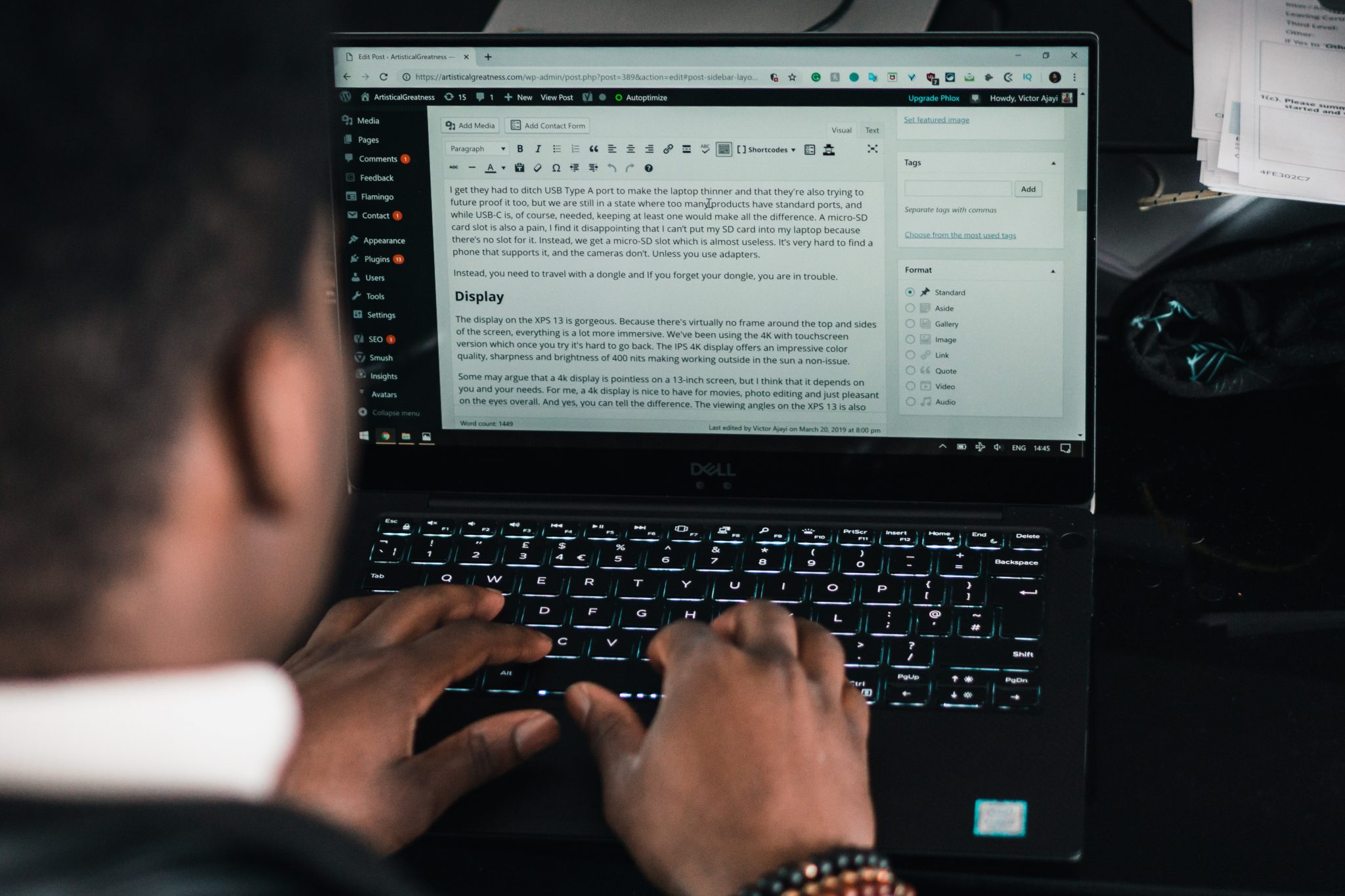 man typing on the dell xps 13