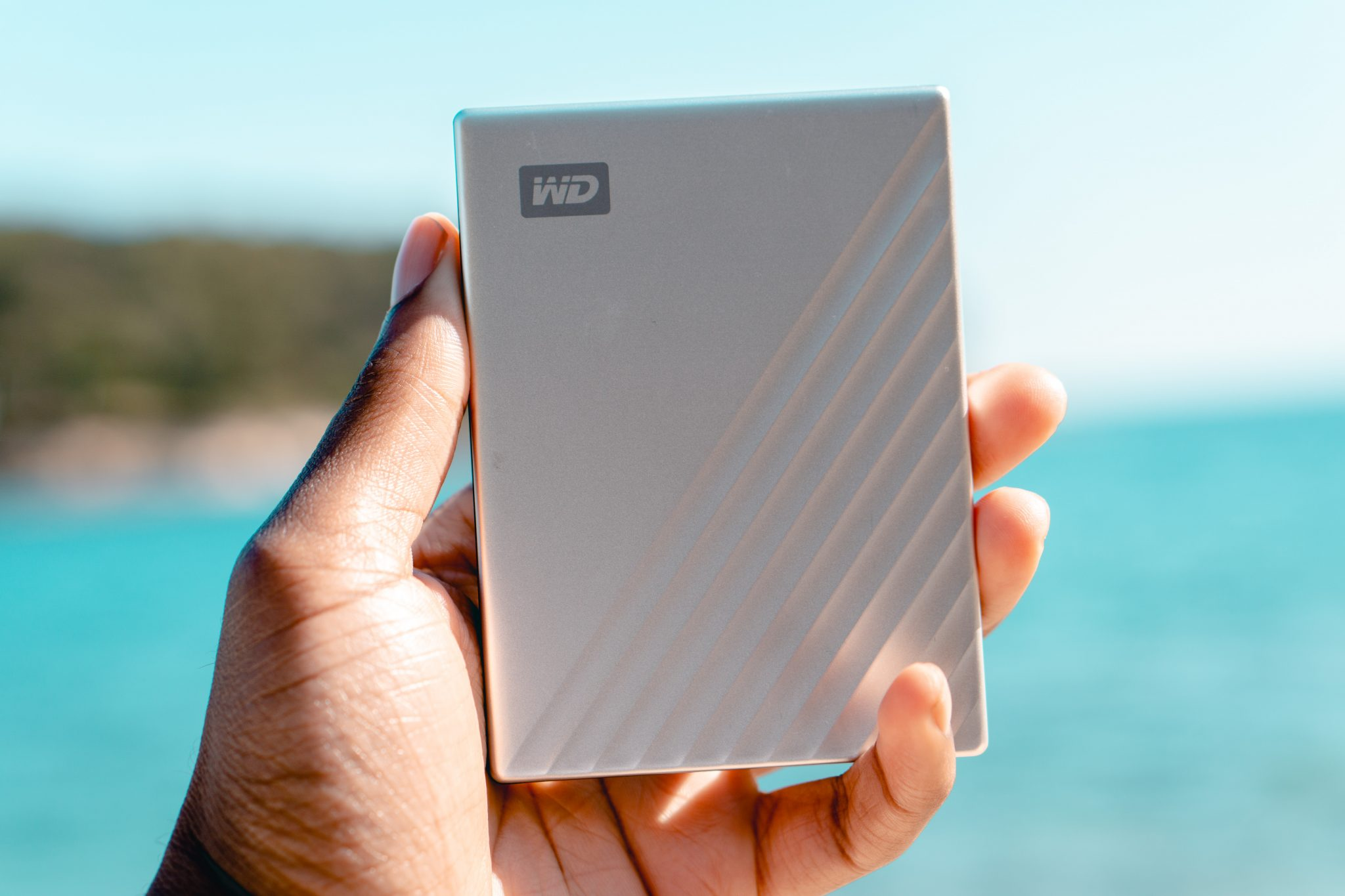 Holding the WD 1TB My Passport Ultra Silver Portable External Hard Drive